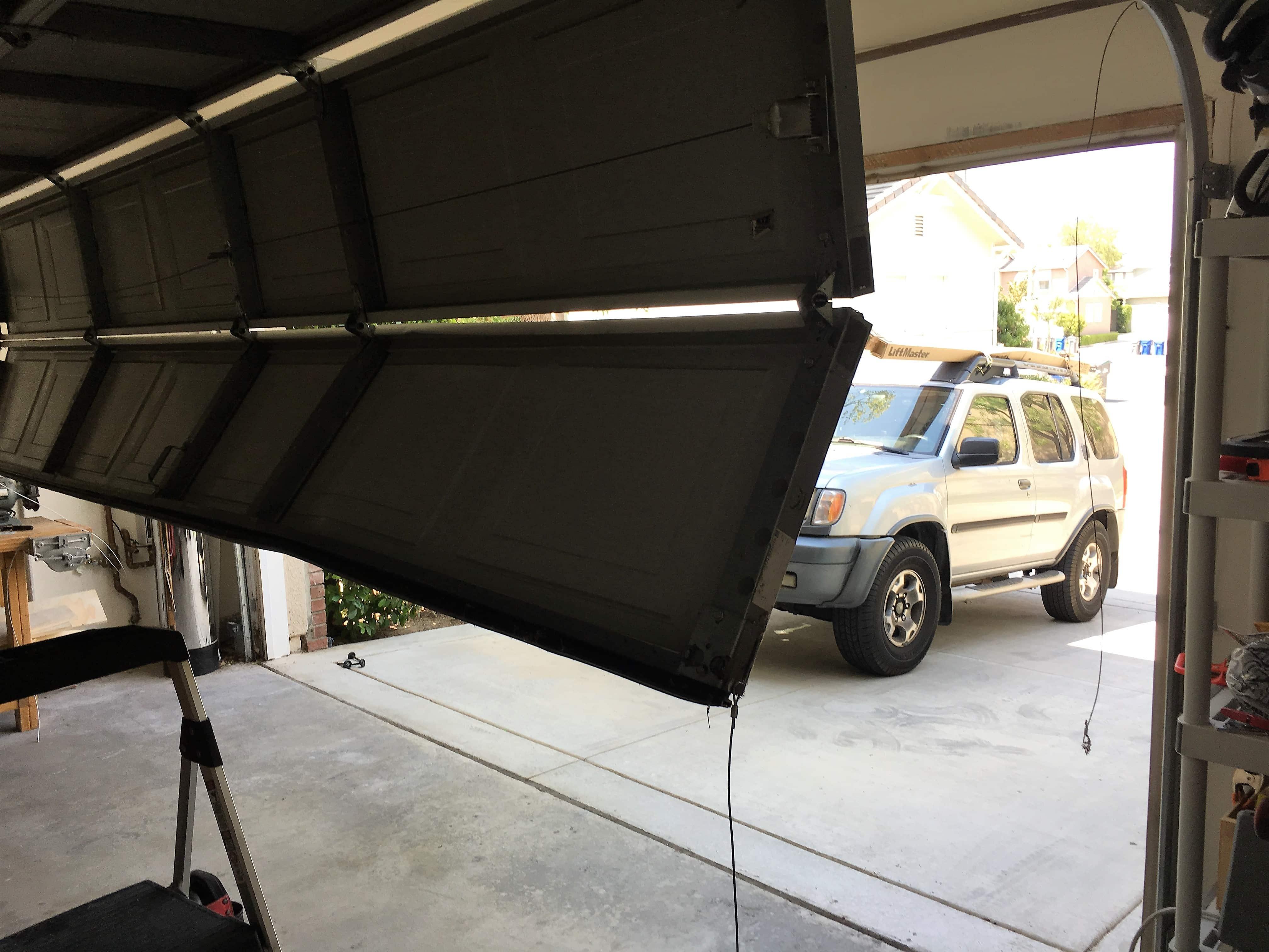 We At AER Garage Door Repair Santa Clarita Specialize In Handling Emergency  Off Track Service.